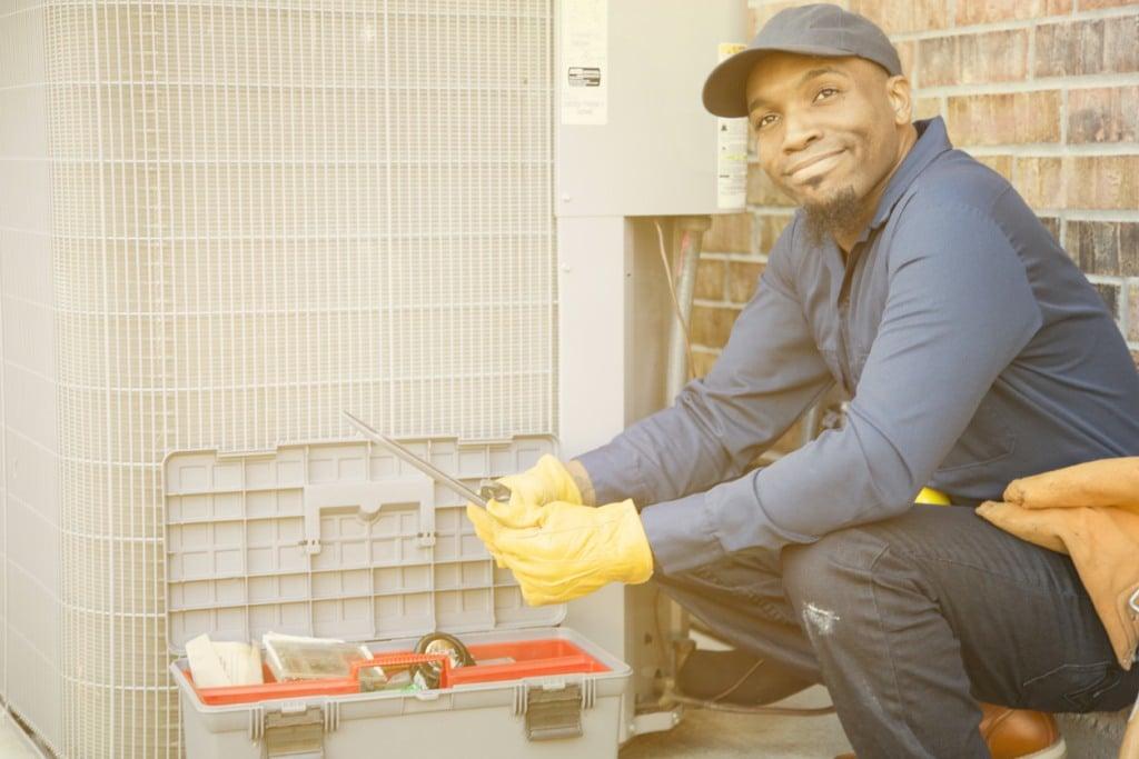 a man worker installs air conditioner in Chesapeake, VA