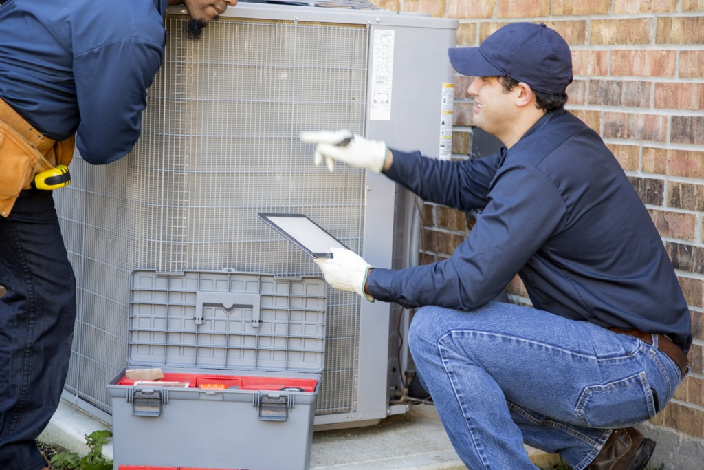 technician repairing an ac system in Portsmouth, VA